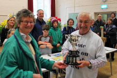 9. President Merrill Bayley presents the WI Cup for Cookery to John Coley