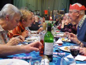Members eating Christmas dinner